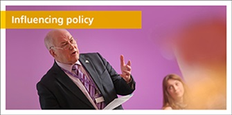 Influencing policy. Man presenting to a group of people.