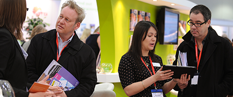 IOSH staff speaking to delegates at the IOSH conference stand