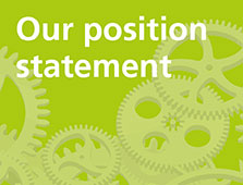 Green cogs with 'our position statement' text