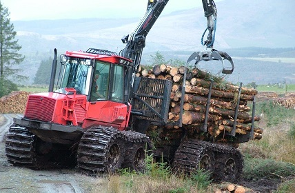 Tractor carrying logs