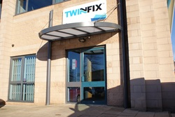 Twinfix head office front door with Twinfix logo above the door