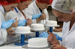Greencore employees in cake manufacturing